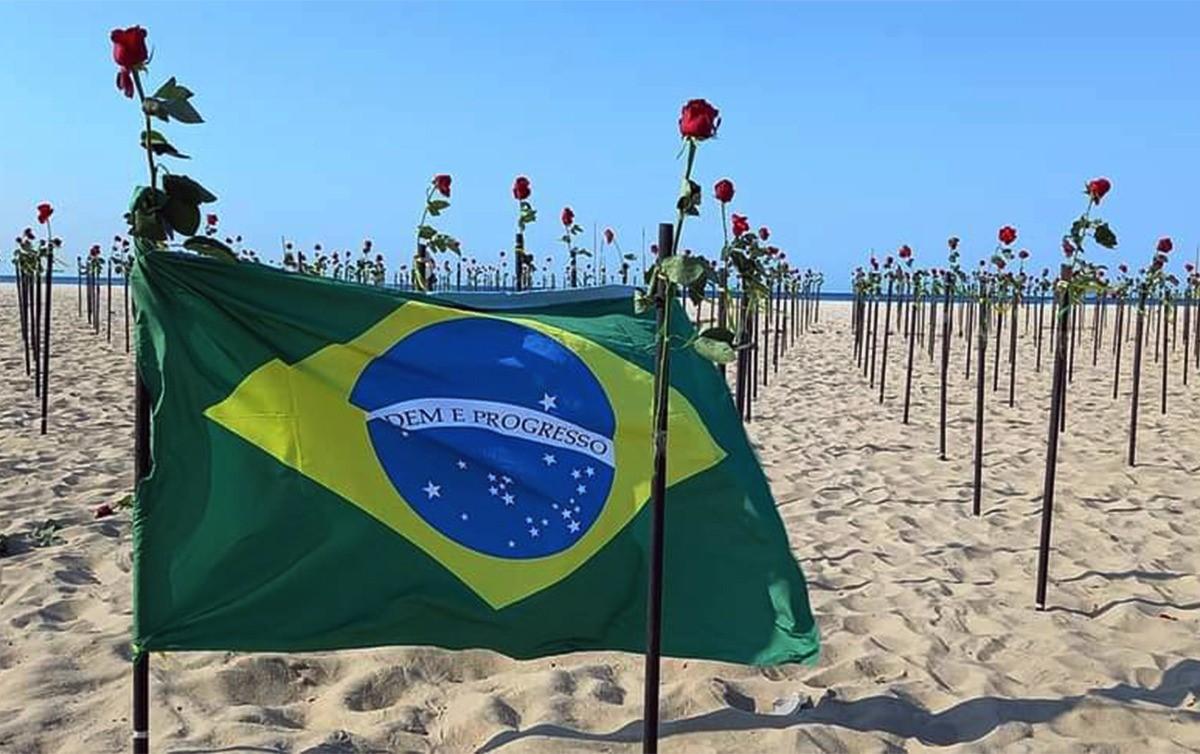 Rosas na praia, sinos tocando: o país em luto pelas 500 mil mortes. Presidente ignora